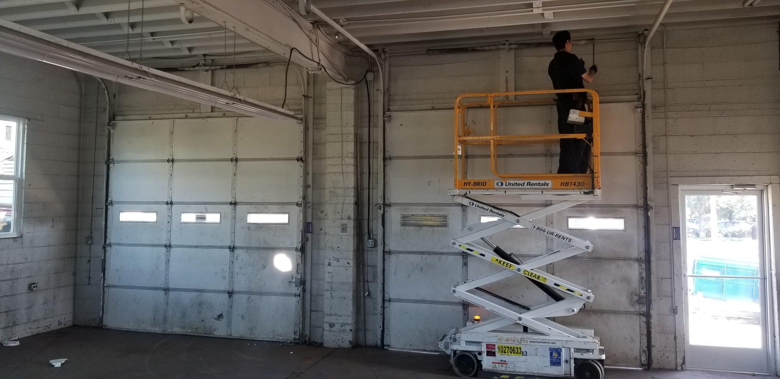 Using Scissor Lift for Garage Door Installation