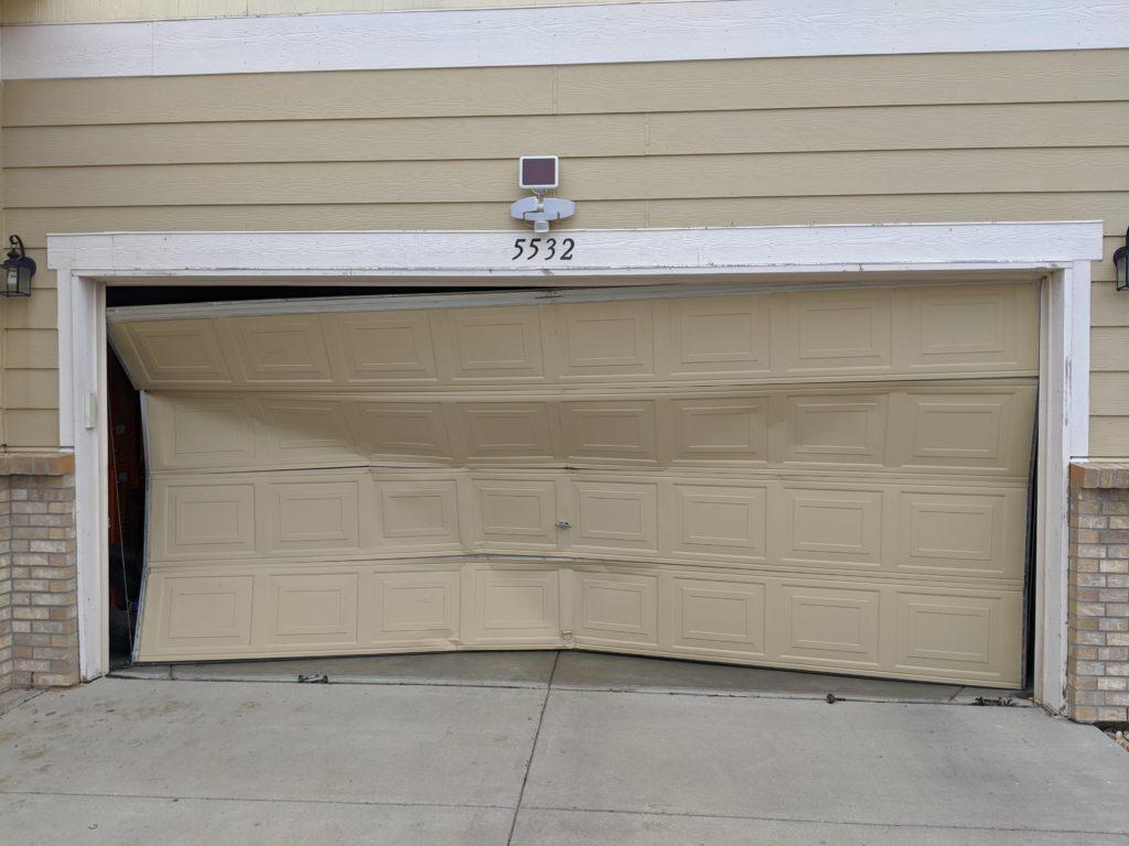 Garage Door After a Car Collision